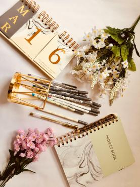 Calender, flowers, pens, notebook, stationery