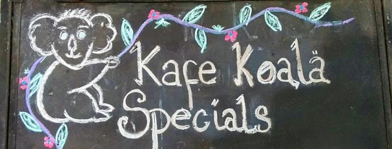 "Scritta ""Kafe Koala Specials"""