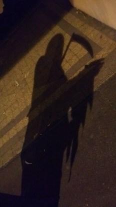 ombra della morte con falce