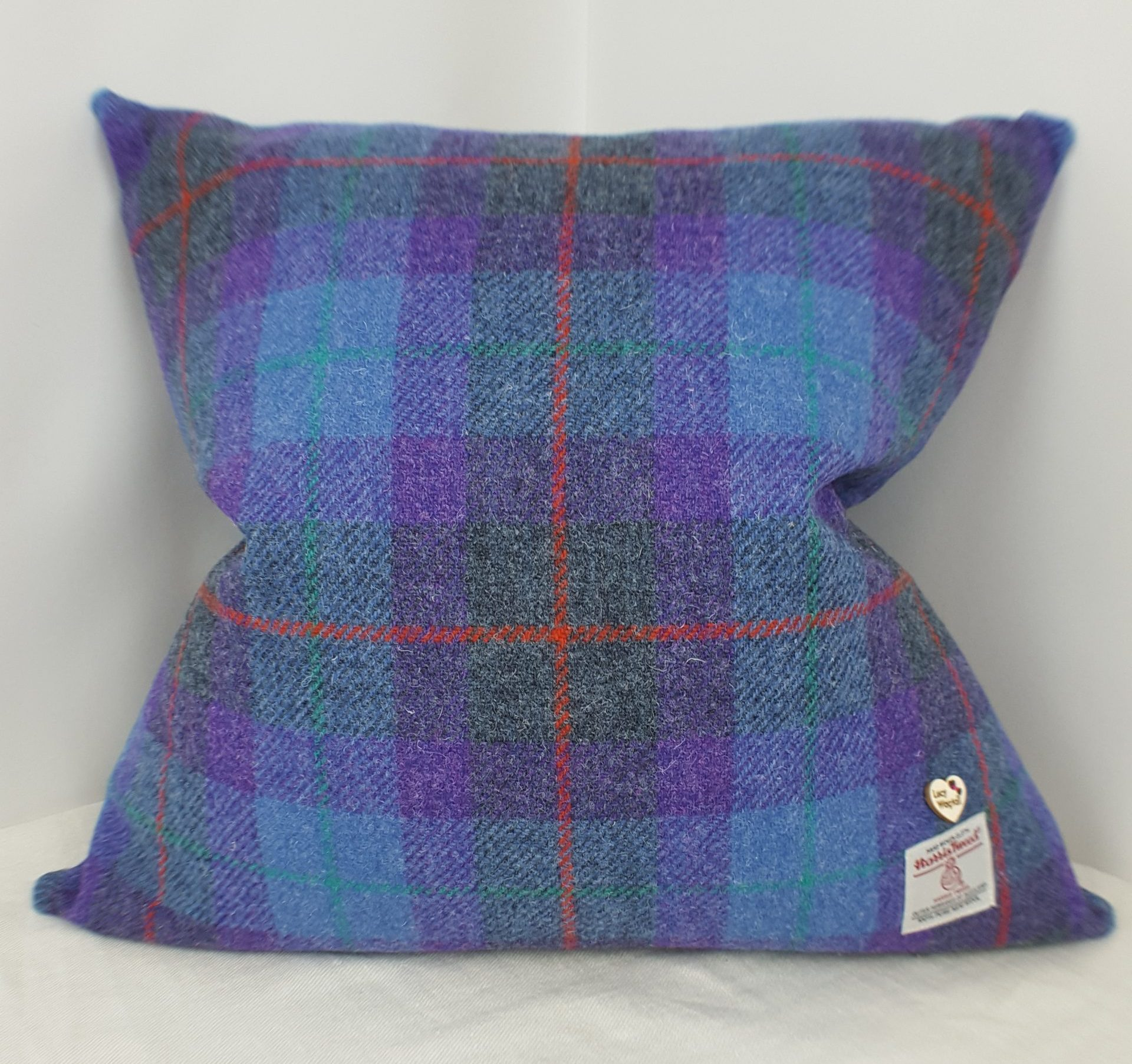 purple blue and grey tartan with red and green overcheck harris tweed cushion cover