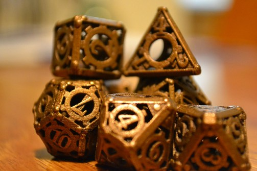 """Bronze Carved Dice"" by Ty Konzak. Used under Creative Commons license CC BY 2.0."