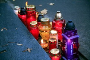 Graveside candles lit for All Saints Day at Powazki Cemetery in Warsaw, Poland.