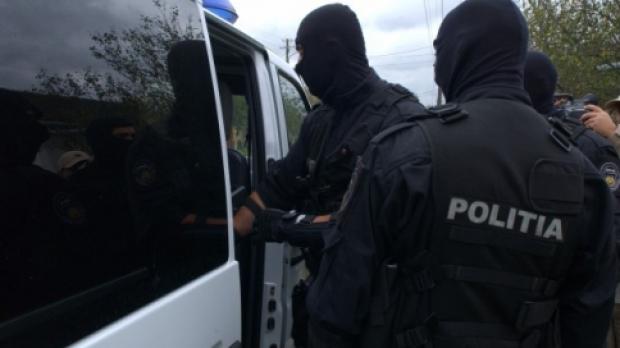 Lugoj Expres O rețea de traficanți de persoane, care acționa în județul Timiș, a fost destructurată trafic de persoane suspecți rețea procurori percheziții grup infracțional DIICOT destructurare