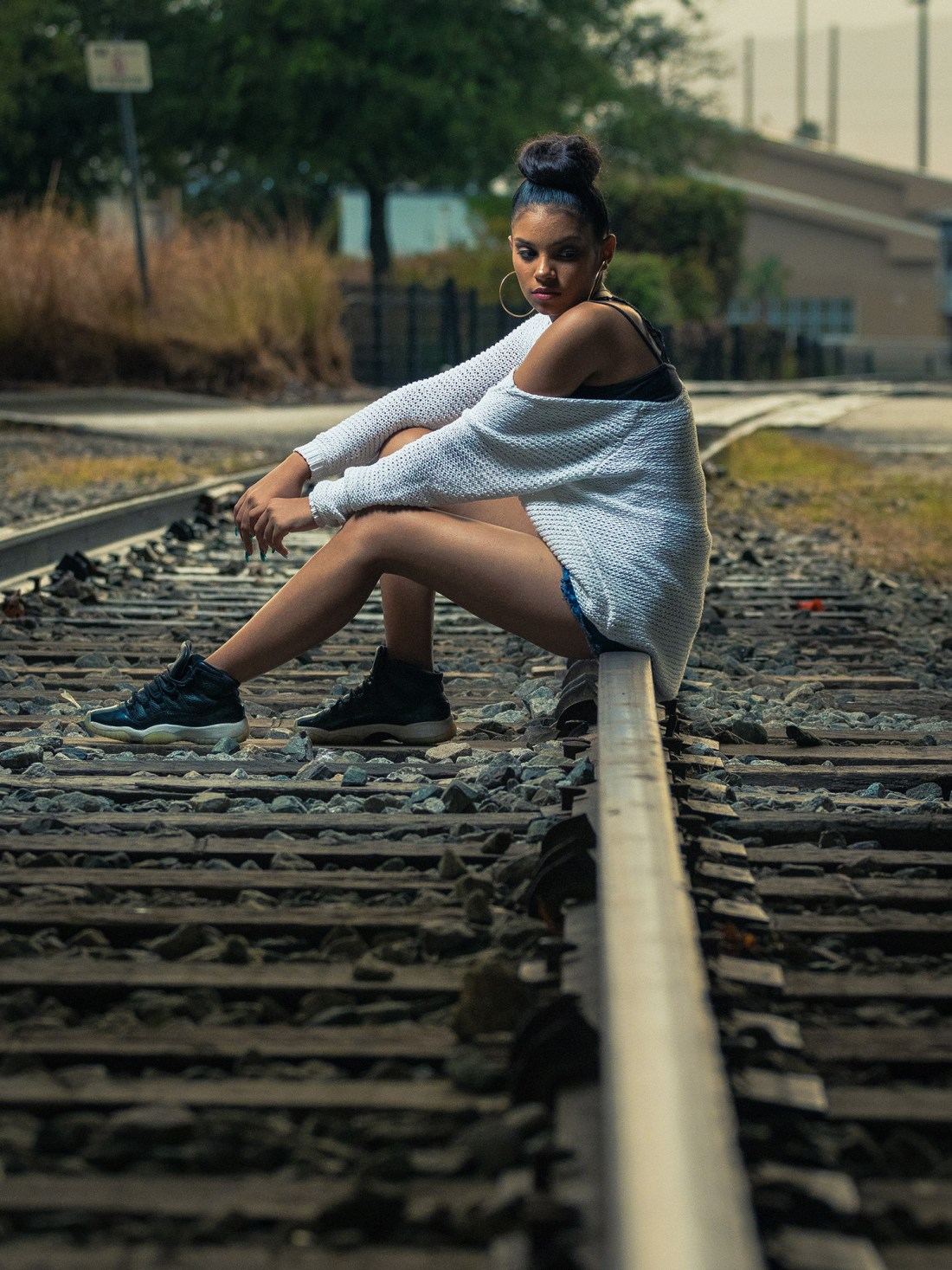 sitting on train rail cool photography luis betancourt photography