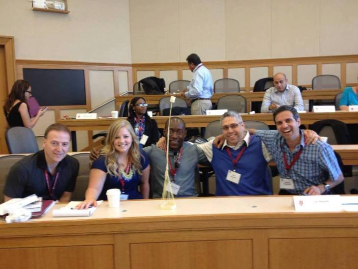 Photo of Dr. Almeida at Harvard University with corporate leaders