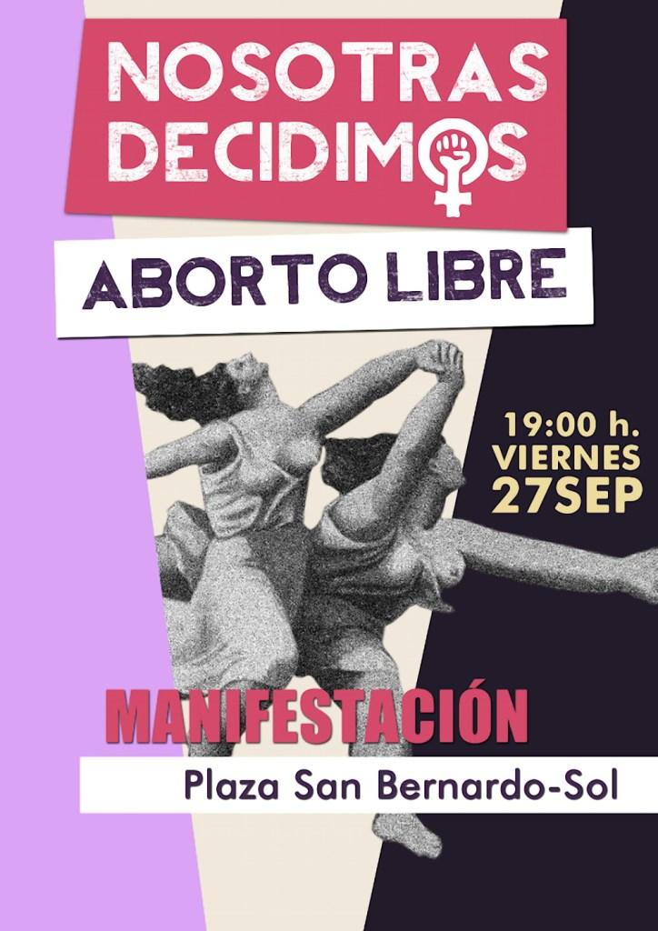 Cartel con el emblema Nosotras Decidimos. Manifestación en Madrid contra la reforma de la ley del aborto del Partido Popular.