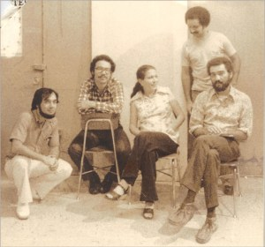 The artists, from left to right: Juan David Cúpeles, Luis M. de Jesús, Myrna Rodríguez, Luis E. Flores (standing) and Lope Max Díaz, on the occasion of a collective exhibition at the Inter-American University of Puerto Rico, Metropolitan Campus, in 1977.