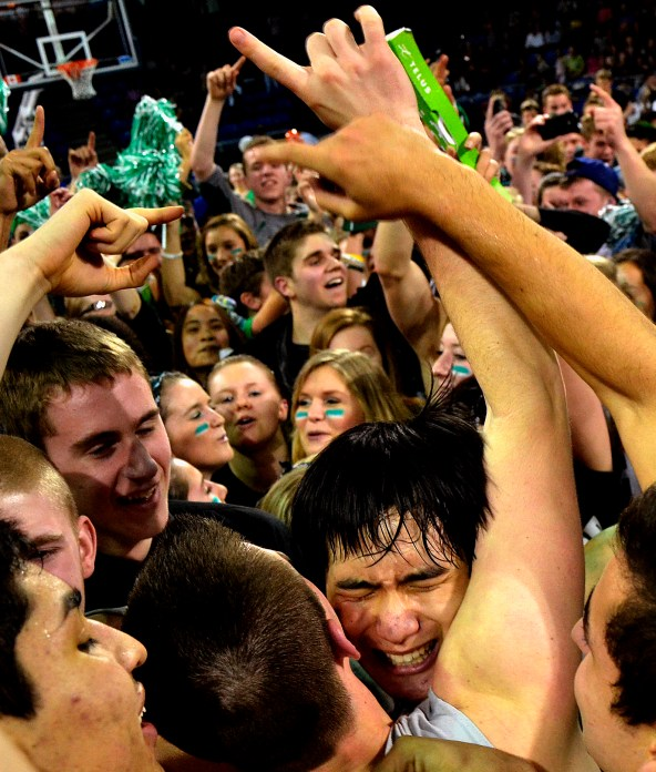 The Walnut Grove Gators celebrate winning the B.C. boys Triple A basketball title at the Langley Events Centre on Saturday, March 16, 2013.