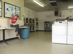 girl studying at a laundromat