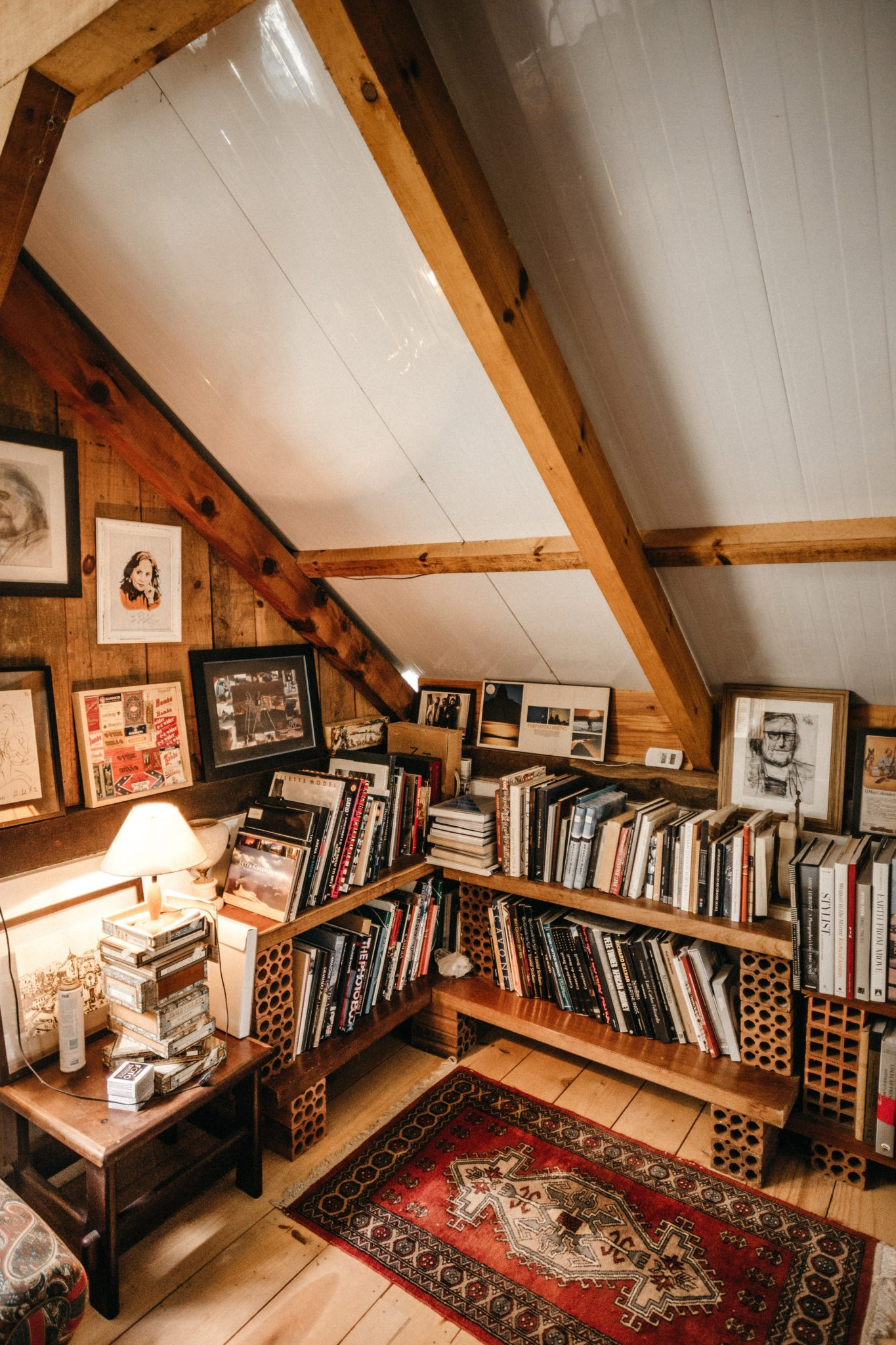 converted loft space full of shelves of books and records