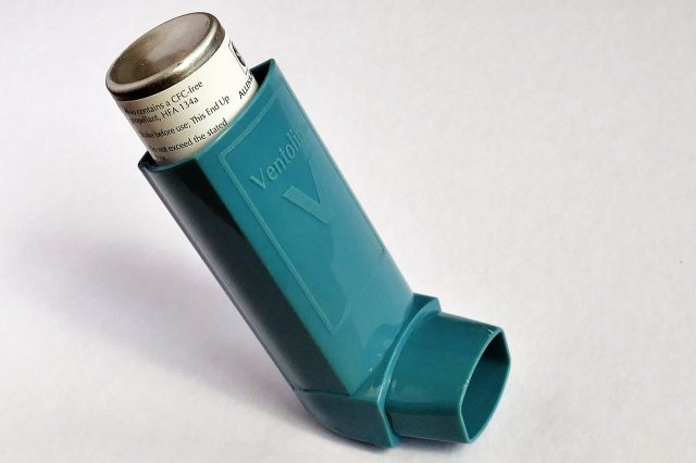 Blue Ventolin inhaler used for asthma. For a post about having asthma and cleaning.