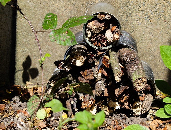 Bug hotel made from recycled tin cans