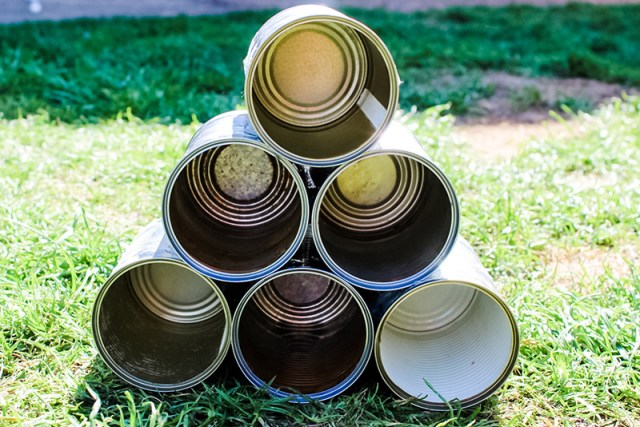 6 recycled tin cans held together with silicone for a blog post about building a bug hotel.