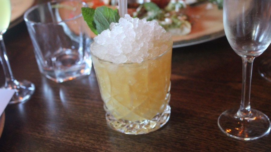 A Rum & Raisin Mai Tai cocktail in a glass.