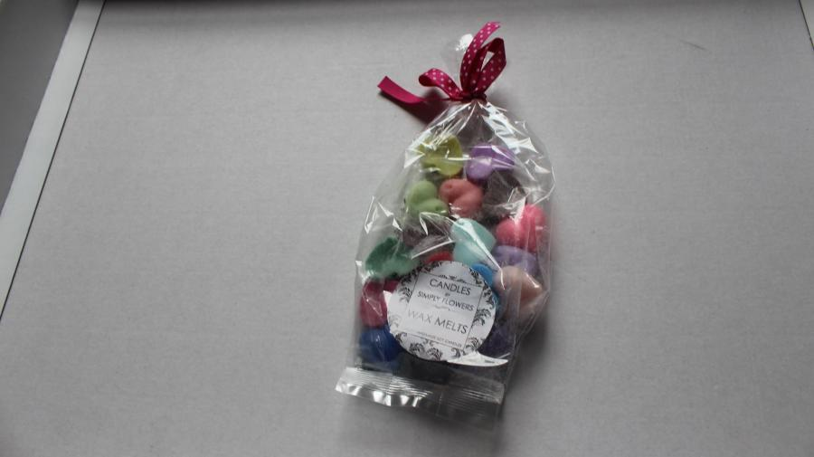 A ribbon tied plastic bag containing 20 heart shaped wax melts.