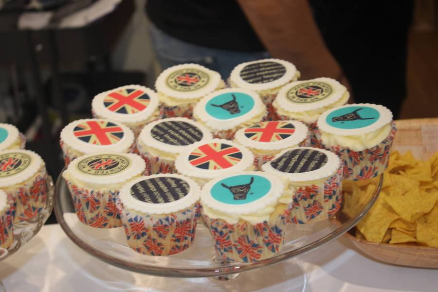 a plate full of cupcakes, some of which have the Ushiwear Clothing logo printed on them.