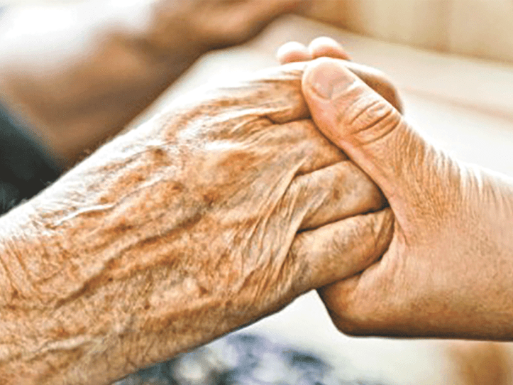 Elderly had holding a younger person's hand