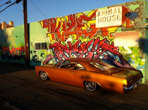"Luke wessmans 66 Impala in front of a friends wall ""Persue"""
