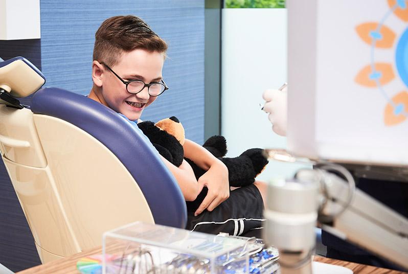 Kid in dentist chair