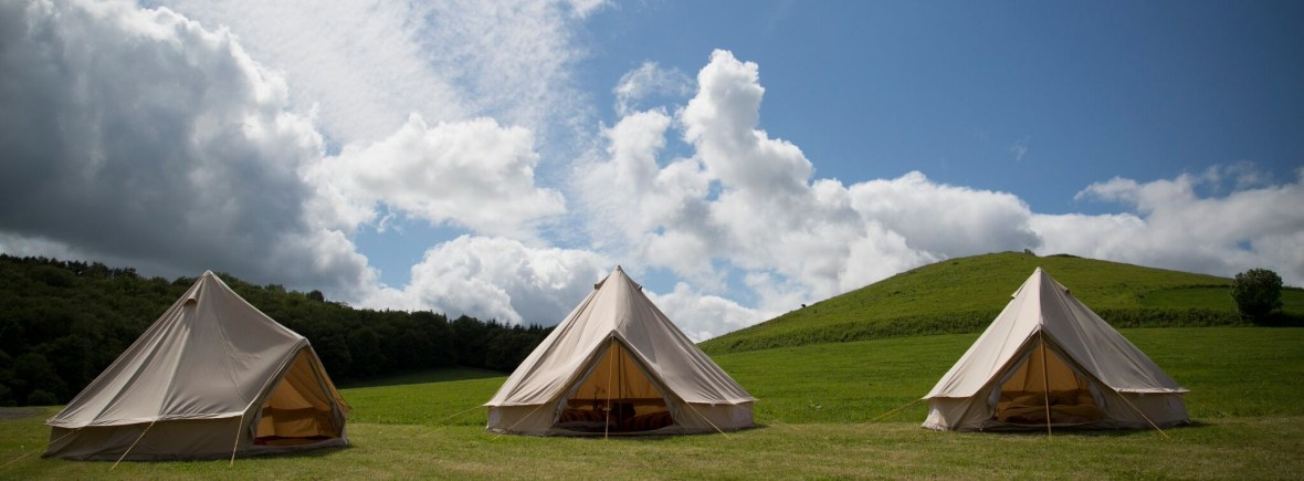 canvas-bell-tents-beautiful-blue-sky-backdrop