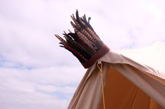 feathered-headdress-on-bell-tent-at-wilderness-festival