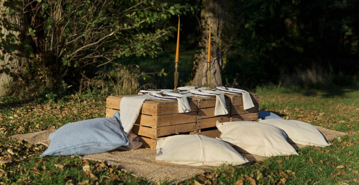 outdoor dining picnic table, rugs and cushions in autumn