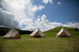 canvas-bell-tents-beautiful-blue-sky-backdrop