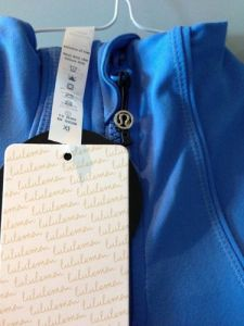 One of the ways you can tell this jacket is fake is that Lululemon never attaches hang tags to rip-out tags. If you see it done this way, it's a fake.