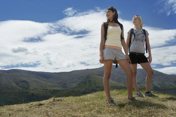 Two Women Wearing Shorts While Hiking