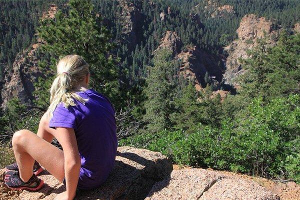 girl hiking in tshirt