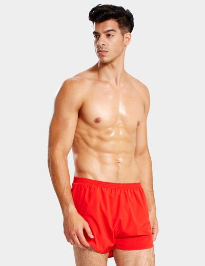 man wearing red swimsuit