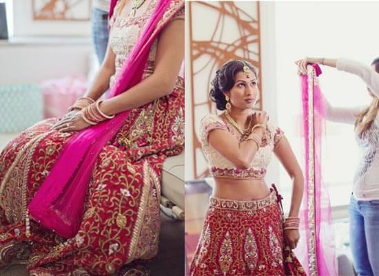 Индийскую невесту одевают в свадебное сари.
