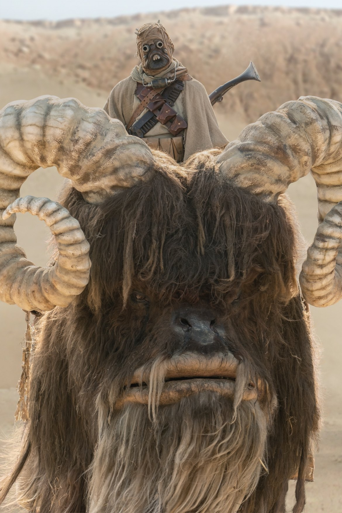 Tusken Raider and bantha in THE MANDALORIAN, season two, exclusively on Disney+
