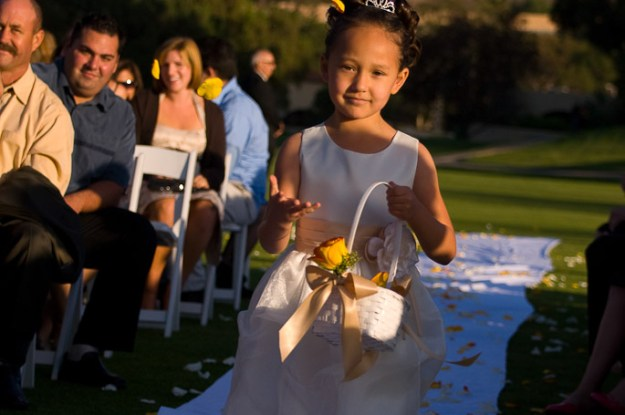 Stop motion image of flowers in the air being thrown by Flower girl