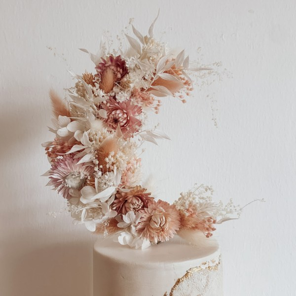 Pink crescent moon dried flower wedding cake topper