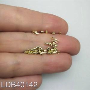 Mostacilla tubo liso bañado en oro de 1.75x2 1gr 60un aprox LDB40142