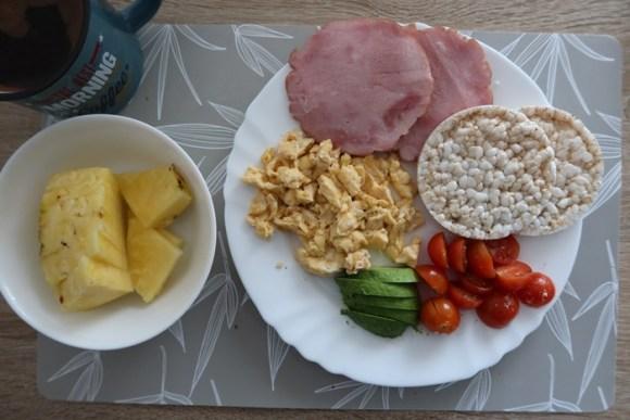 Sunday Breakfast - eggs, ham, rice cake, tomatoes, avocado, pineapple, coffee