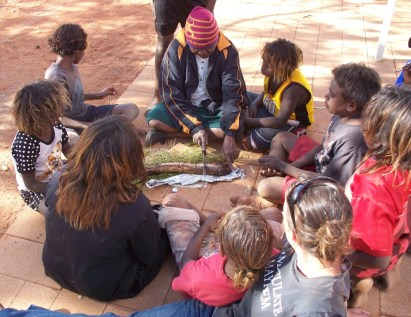 Learning to cook kangaroo tail, Central Australia.