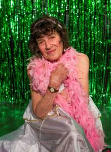 Lynn Ruth Miller with pink feather boa wrapped around her