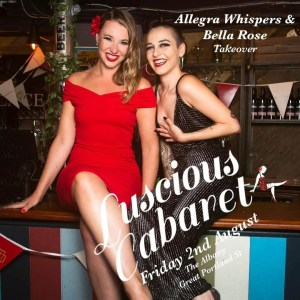 Bella Rose dressed in Red and Allegra Whispers dressed in black sat on a bar with the words Luscious Cabaret Friday 2nd August across it