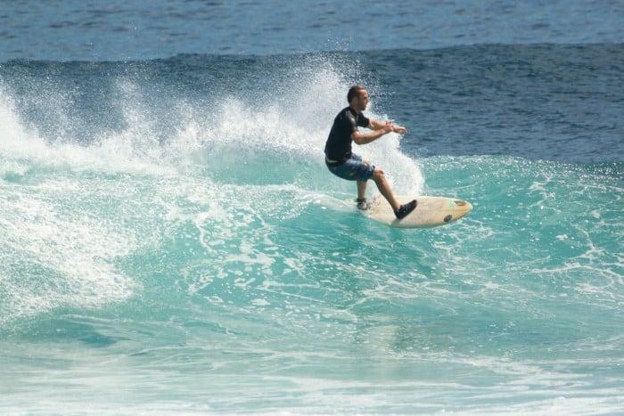 Guide to Surfing Bali | Balangan break wearing reef booties
