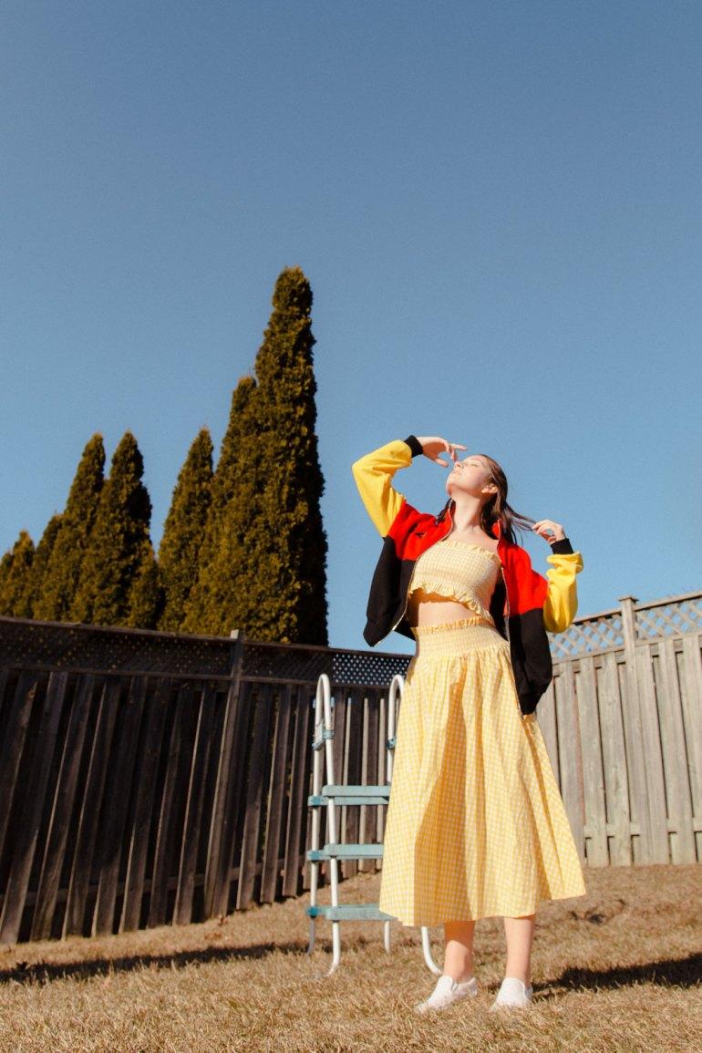 Emily Gilmore—Girl in yellow dress in backyard