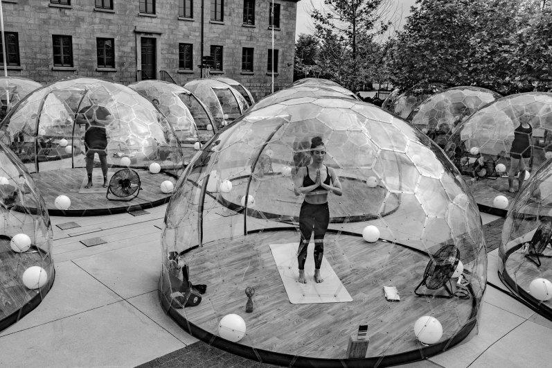 Bubble yoga in Toronto park by George Pimentel