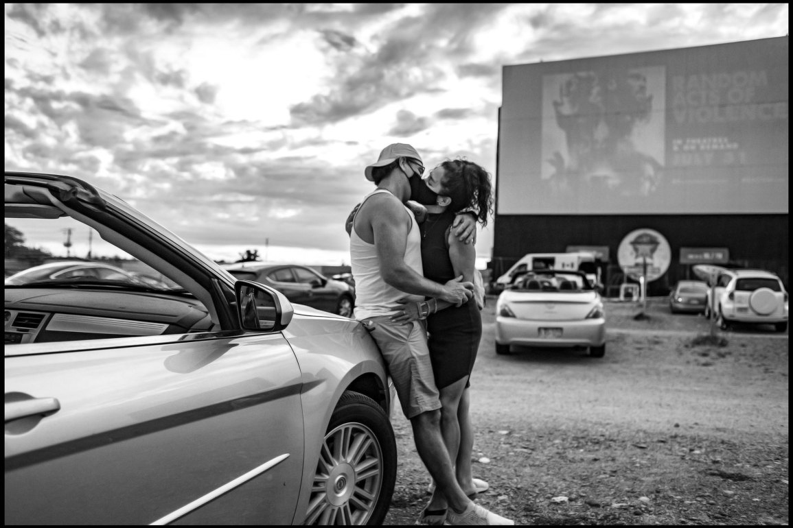 masked kissing at a drive-in Toronto by George Pimentel