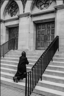Luso–Life - Canada COVID Portrait - woman kneeling at church in Toronto by George Pimentel