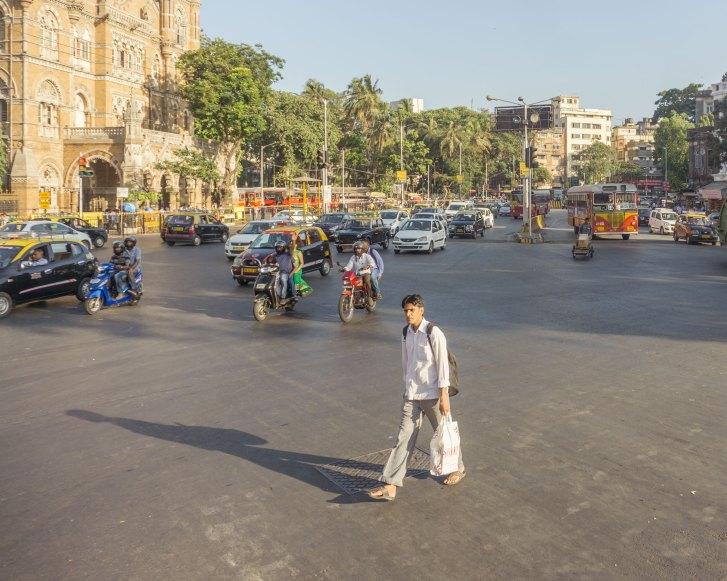 Man crossing street in Mumbai
