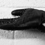 spiked glove for a handjob