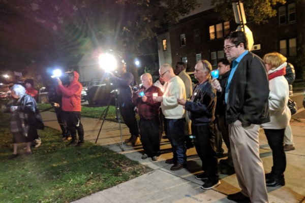 St. Timothy - Peace Vigil at Encuentro 2018 being filmed by news crews