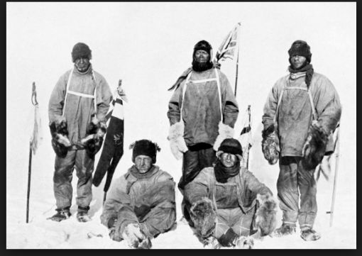 Scott (standing next to Brit flag) and team looking rather chagrined after finding the Pole, but also finding that Amundsen got there first.