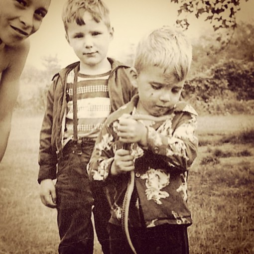 The Dude gets up close and personal with a snake while  Brother Bill and Cousin Charlie look on.